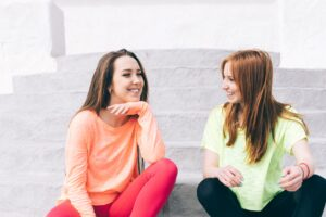 two-young-friends talking-