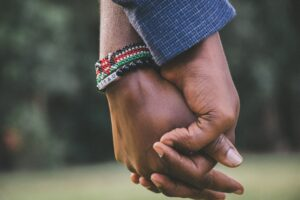 close-up-photo-of-two-person-s-holding-hands-1667849